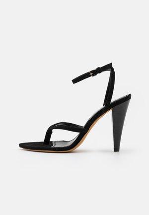 CADIZ - T-bar sandals - black