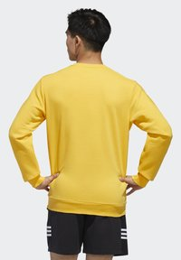 adidas Performance - ESSENTIALS TRAINING SPORTS PULLOVER - Mikina - active gold/white - 1