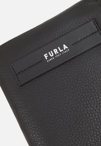 Furla - TECHNICAL CROSSBODY POUCH UNISEX - Across body bag - nero - 5