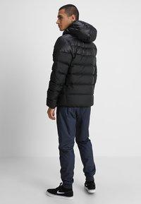 Nike Sportswear - Down jacket - black/white - 2