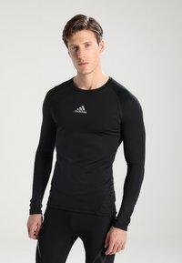 adidas Performance - Camiseta de deporte - black - 0