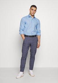 Calvin Klein Tailored - STRETCH - Formal shirt - light blue - 1