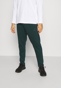 4F - Men's sweatpants - Tracksuit bottoms - dark green - 0
