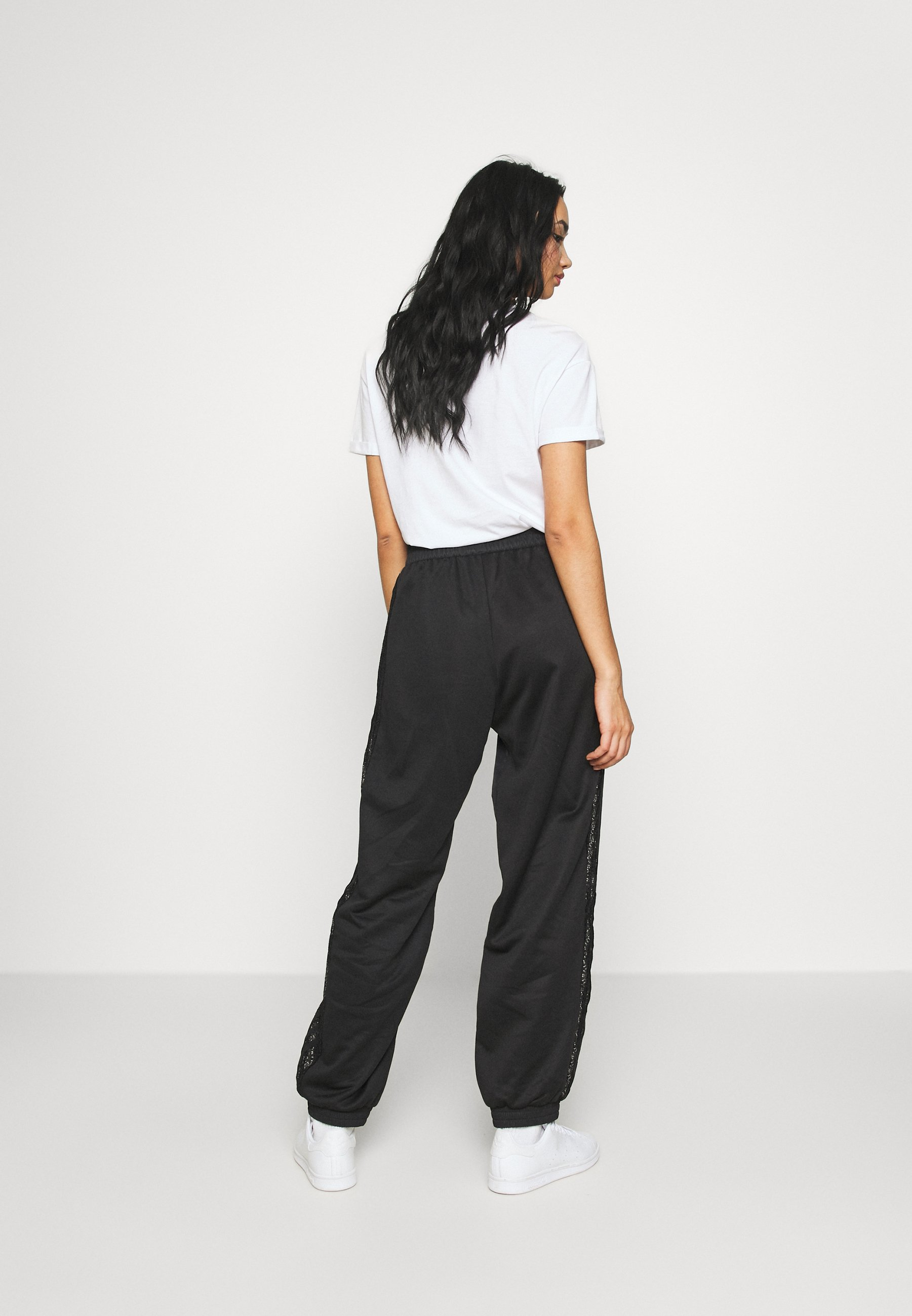 adidas Originals BELLISTA NYLON CUFFED SPORT PANTS - Pantalon de survêtement - black - Pantalons & Leggings Femme W9UUV