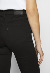 Levi's® - 720 HIRISE SUPER SKINNY - Jeans Skinny Fit - black galaxy - 6