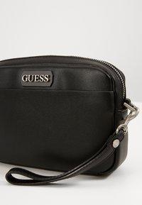 Guess - DAN SMALL NECESSAIRE - Across body bag - black - 3