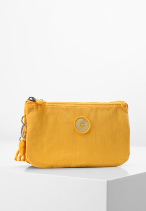 CREATIVITY L - Wallet - vivid yellow