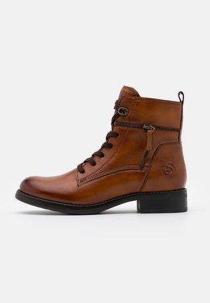 SINJA - Lace-up ankle boots - cognac