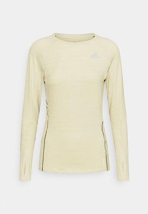 ADI RUNNER - Camiseta de deporte - sand