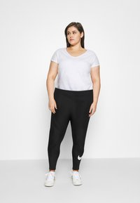 Nike Sportswear - Leggings - Trousers - black - 1