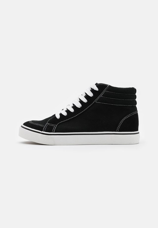 JOEY - Korkeavartiset tennarit - black