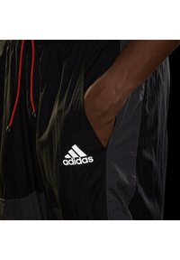 adidas Performance - Tracksuit bottoms - black/black - 3