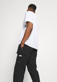 adidas Originals - UTILITY TWO IN ONE ORIGINALS - Pantalon cargo - black - 3