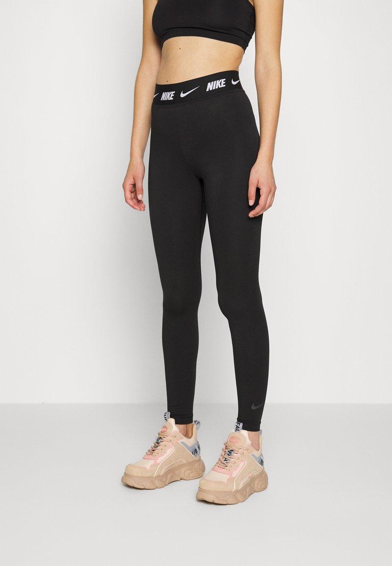 Nike Sportswear - CLUB - Leggings - black