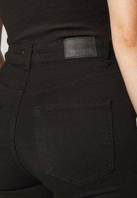 Gina Tricot Petite - NATASHA  - Bootcut jeans - black - 4