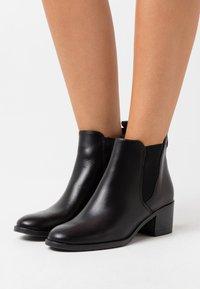 Tamaris - Ankle boots - black - 0