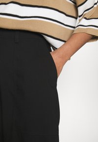 Weekday - JINA TROUSER - Trousers - black dark - 4