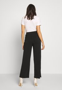 ONLY - ONQGAIA WIDE PANT - Trousers - black - 2
