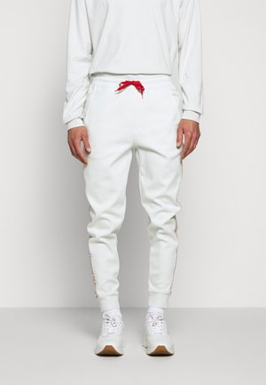 DAKY - Tracksuit bottoms - natural