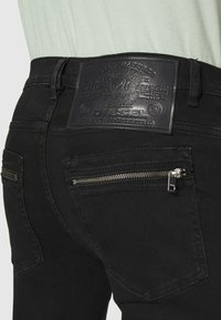 Diesel - D-AMNY-BK-SP1 - Jeans Skinny Fit - 009RB - 4