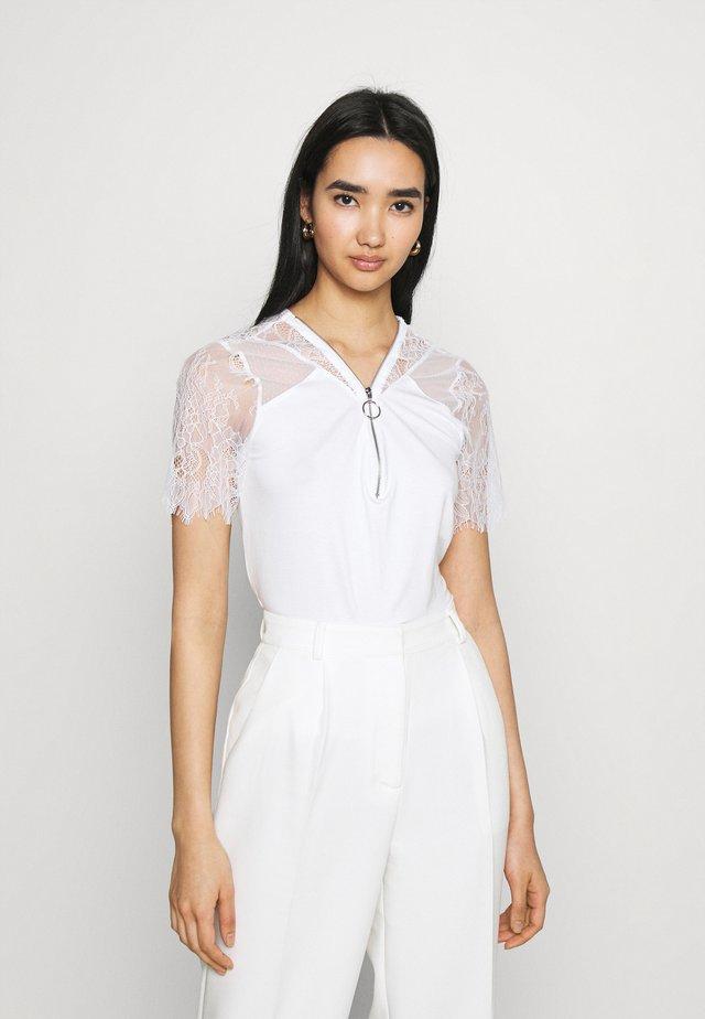 DAYANA - T-Shirt print - off white