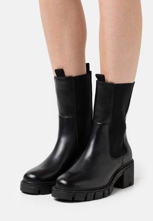 VMRIKKO BOOT - Platform ankle boots - black