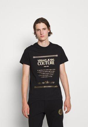 Print T-shirt - nero/oro
