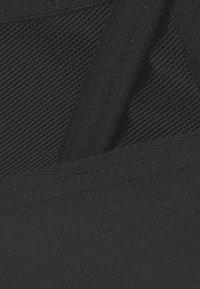 Reebok - LUX STRAPPY BRA - Light support sports bra - black - 5