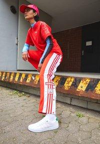 adidas Originals - ADIBREAK - Pantalones deportivos - red - 1