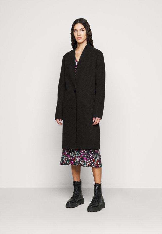 COLLARLESS UNLINED COAT - Mantel - black