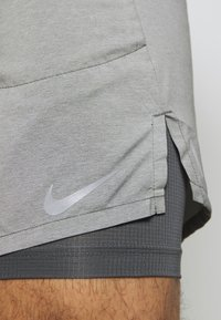 Nike Performance - STRIDE 2IN1 - Sports shorts - iron grey/reflective silver - 6