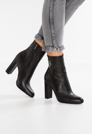 EDITOR - High heeled ankle boots - black