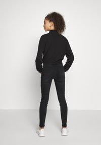 ONLY Petite - ONLCHRISSY   - Jeans Skinny Fit - black - 2