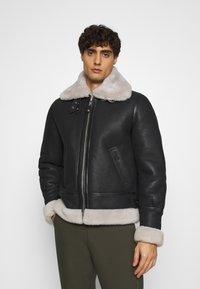 Schott - Leather jacket - black/offwhite - 0