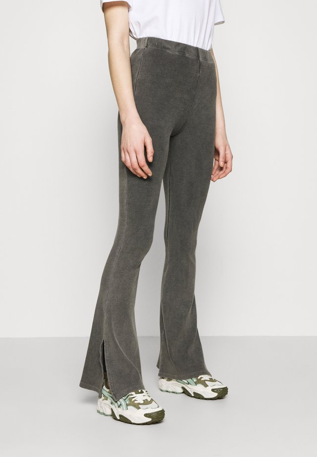ACID SPLIT FLARE - Trousers - black