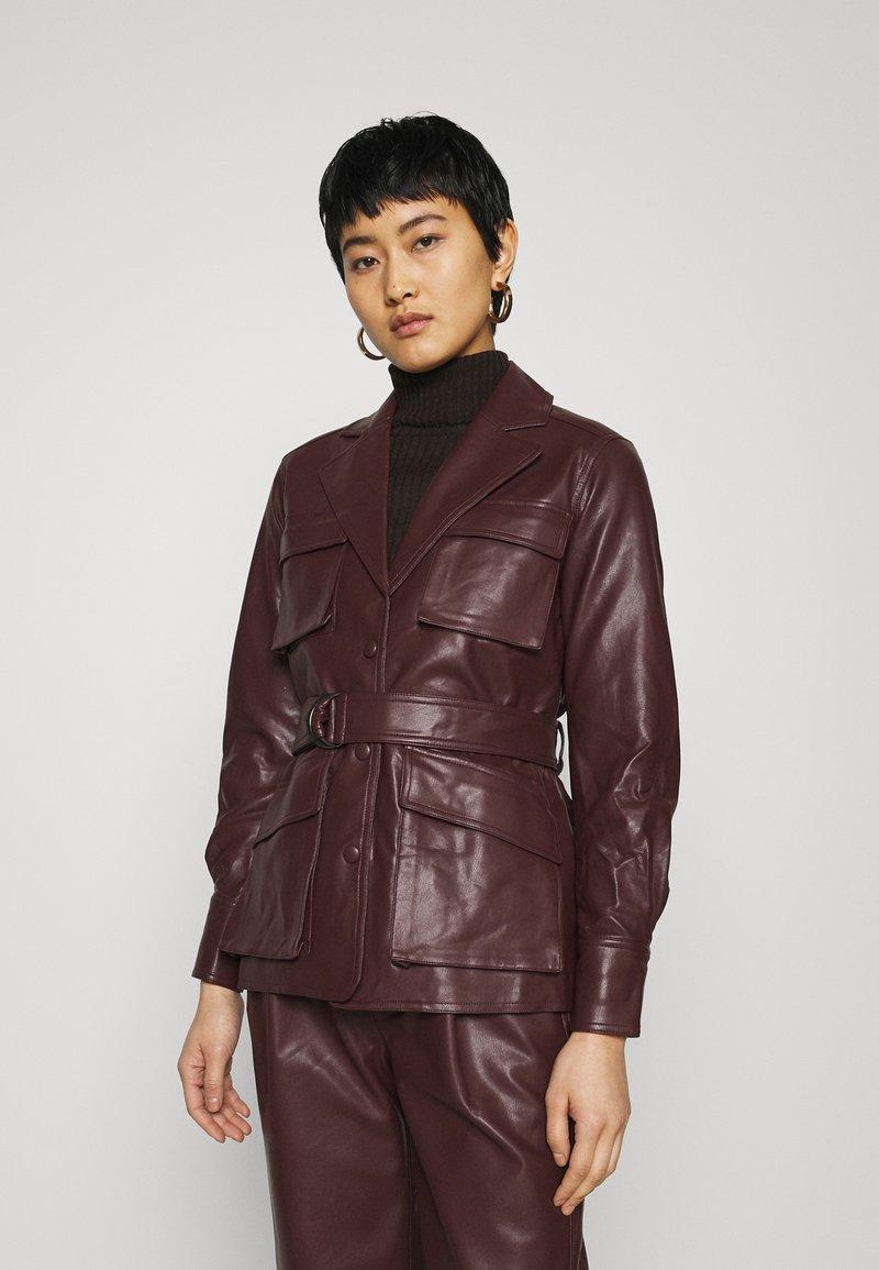 Twist & Tango - CECILIA JACKET - Faux leather jacket - reddish brown