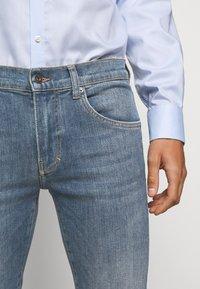 J.LINDEBERG - JAY ACTIVE - Jeans slim fit - light blue - 3