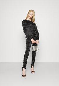 Weekday - SMOCK TROUSER - Pantalones - black - 1