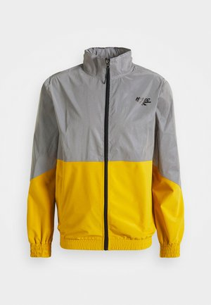 MELVIN COLOURBLOCK REFLECTIVE TRACK JACKET - Training jacket - golden glow