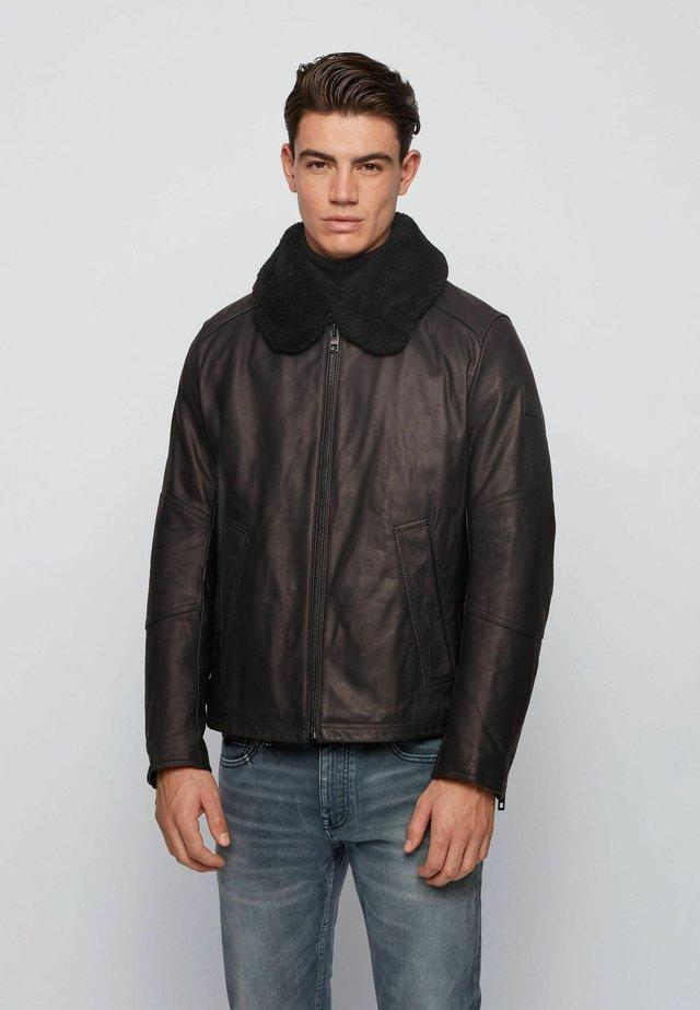 JANKA - Leather jacket - black