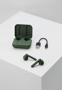 Urbanista - STOCKHOLM TRUE WIRELESS EARPHONES - Headphones - olive green - 4