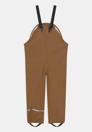 BASIC RAIN UNISEX - Kalhoty do deště - mustard yellow