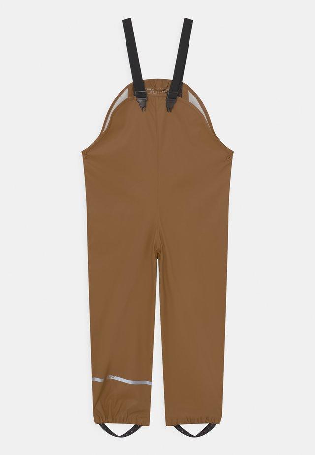 BASIC RAIN UNISEX - Rain trousers - mustard yellow