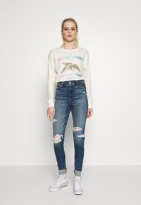 American Eagle - BEACH LONG SLEEVE TEE ROLLING STONES - Long sleeved top - natural white - 1