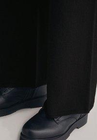 Falconeri - PALAZZO - Trousers - black - 2