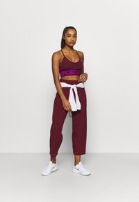 Nike Performance - PANT - Tracksuit bottoms - dark beetroot/metallic silver - 1