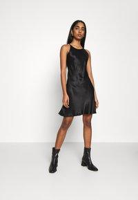 Weekday - NOELLA STRAPPY DRESS - Vestido de cóctel - black - 0