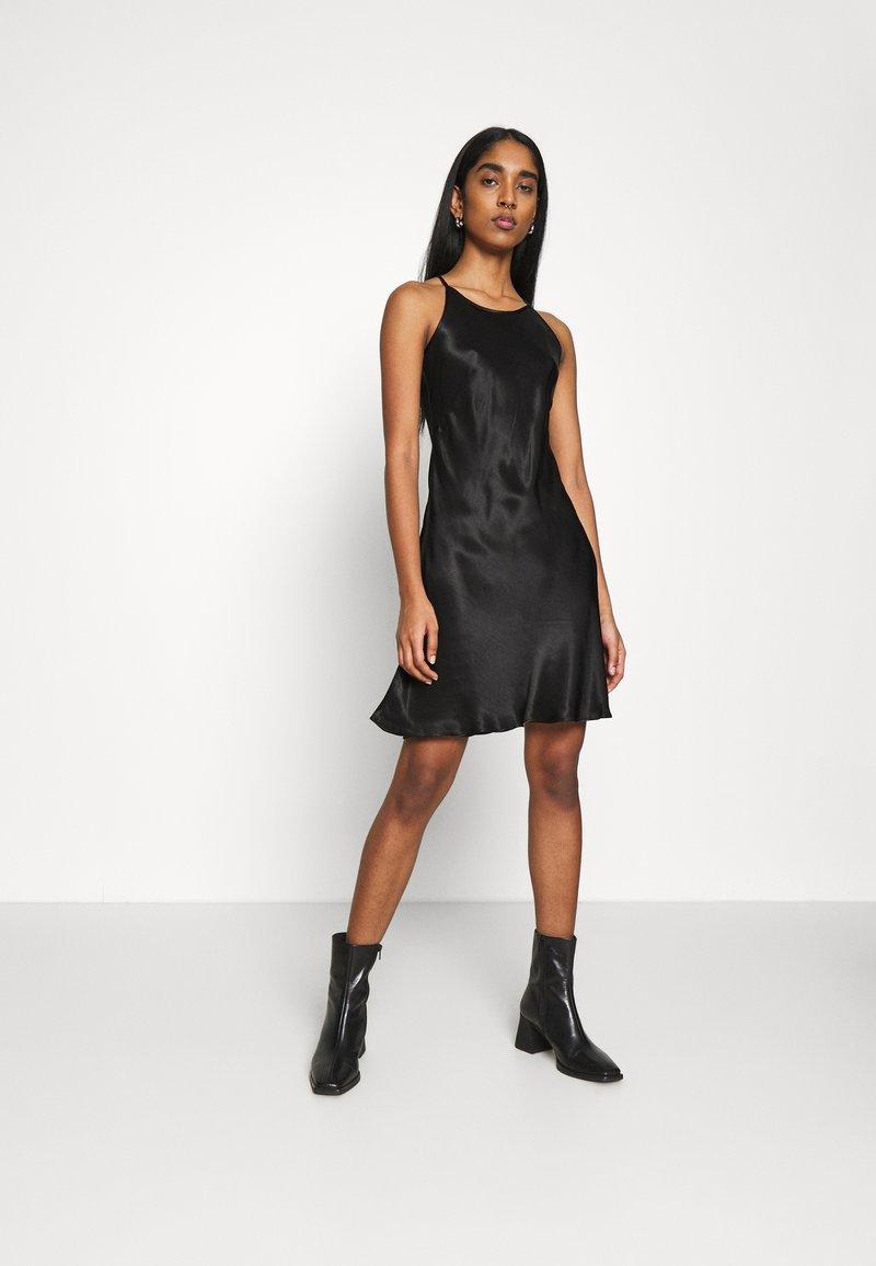 Weekday - NOELLA STRAPPY DRESS - Vestido de cóctel - black