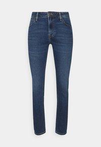 MALONE - Slim fit jeans - acid red ville