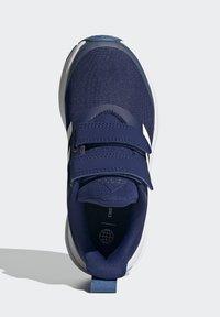 adidas Performance - FORTARUN - Stabilty running shoes - blue - 3